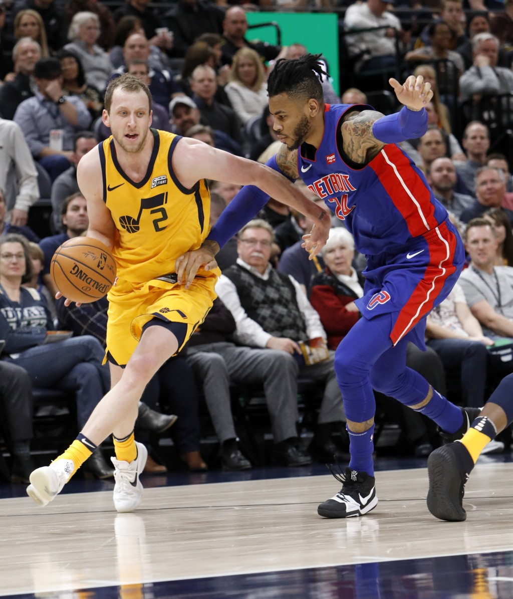 Utah Jazz's Joe Ingles (2) dribbles after stealing the ball from Detroit Pistons' Eric Moreland, right, in the first half of an NBA basketball game on