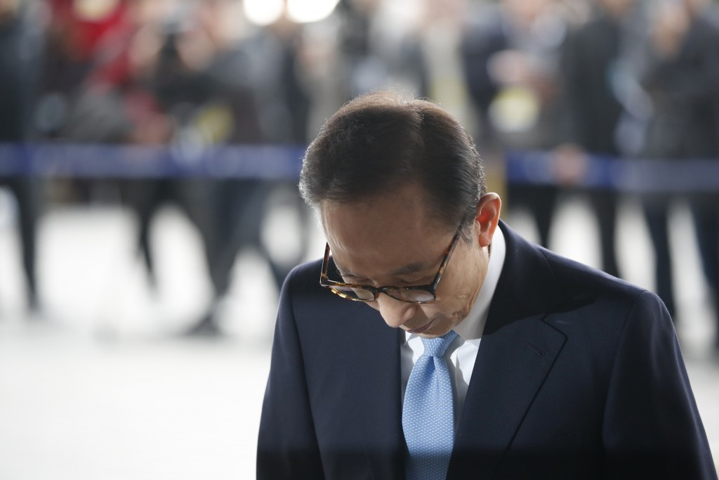Former South Korean President Lee Myung-bak arrivesl for questioning over bribery allegations at the Seoul Central District Prosecutors' Office in Seo