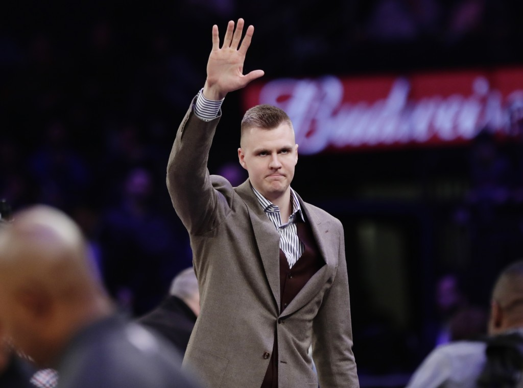 New York Knicks' Kristaps Porzingis (6) waves to fans before an NBA basketball game against the Dallas Mavericks Tuesday, March 13, 2018, in New York.