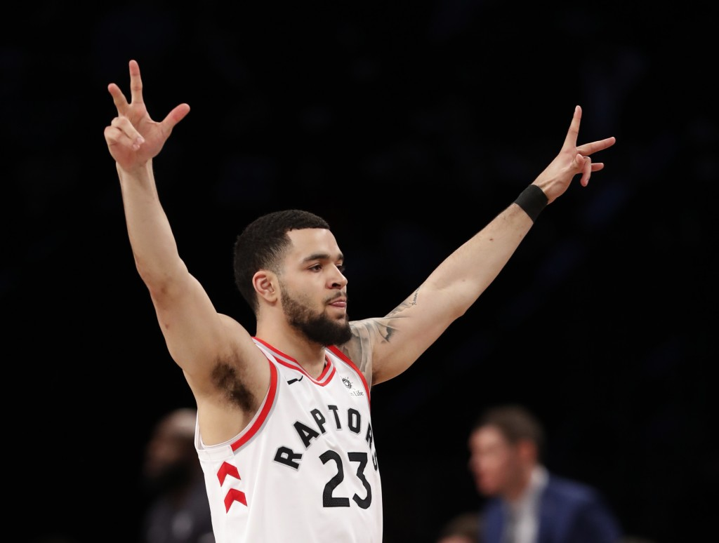 Toronto Raptors guard Fred VanVleet (23) gestures toward the Raptors bench after hitting a 3-point shot during the second half of an NBA basketball ga