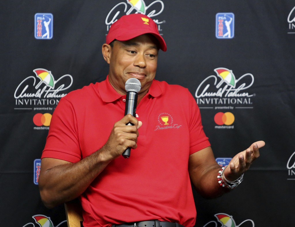 Tiger Woods shrugs while responding to a reporter's question during a news conference at the Arnold Palmer Invitational golf tournament at Bay Hill, T