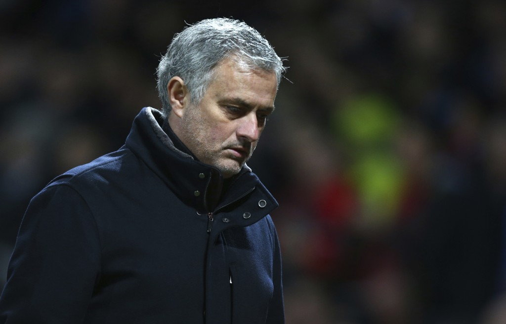 Manchester United head coach Jose Mourinho walks to the dressing room aft half time during the Champions League round of 16 second leg soccer match be