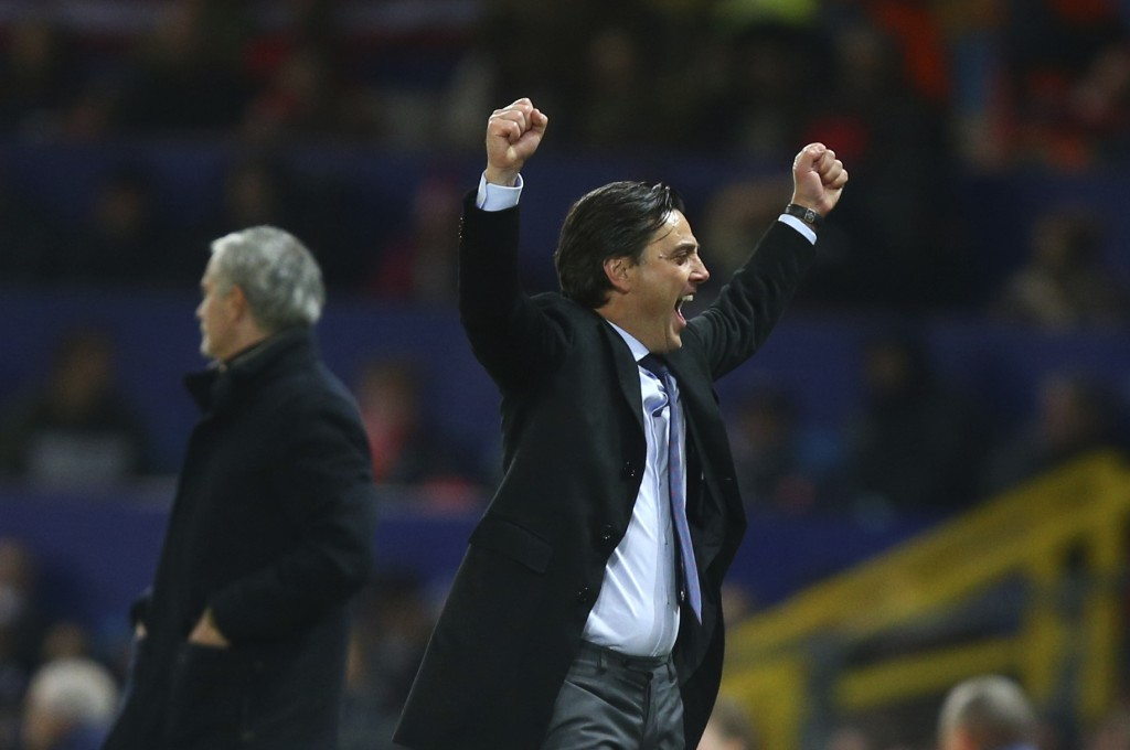 Sevilla's head coach Vicenzo Montella celebrates after his sides scored their second goal of the game during the Champions League round of 16 second l