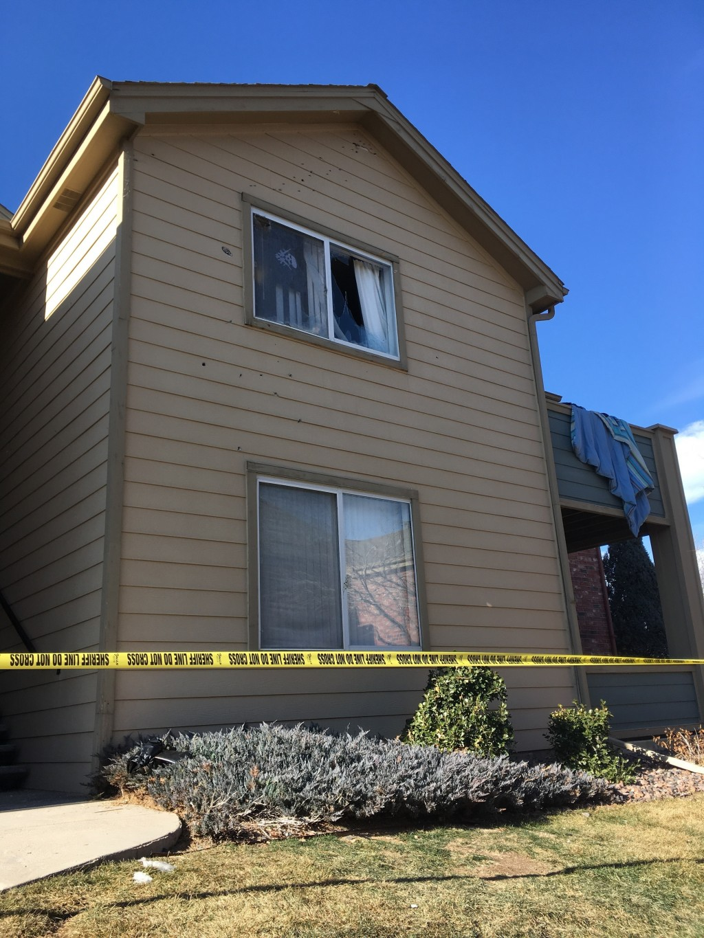FILE - In this Jan. 1, 2018, file photo, Deputy Zack Parrish's a suburban Denver apartment building where he was fatally shot is riddled by bullet hol