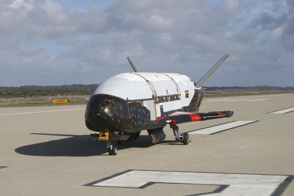 This June 2009 photo provided by the U.S. Air Force via NASA shows the X-37B Orbital Test Vehicle at Vandenberg Air Force Base, Calif. President Donal