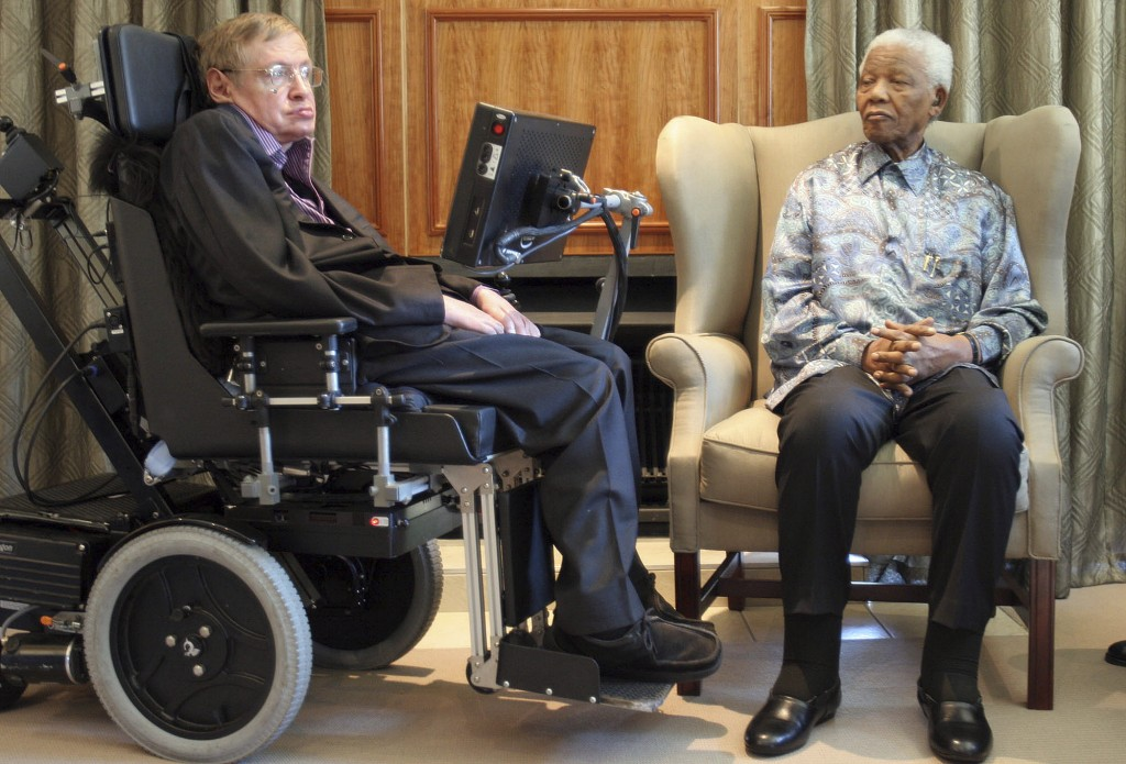 FILE - In this Thursday, May 15, 2008 file photo former South African President Nelson Mandela, right, meets with British scientist Professor Stephen