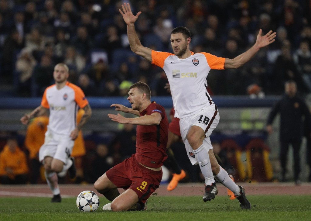 Roma's Edin Dzeko is fouled by Shakhtar's Ivan Ordets during a Champions League round of 16 second-leg soccer match between Roma and Shakhtar Donetsk,