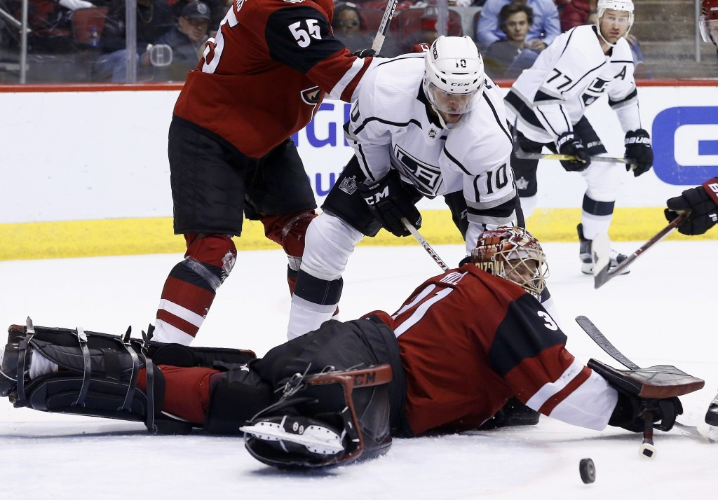 Arizona Coyotes goaltender Adin Hill, right, makes a save on a shot by Los Angeles Kings center Tobias Rieder (10) during the first period of an NHL h