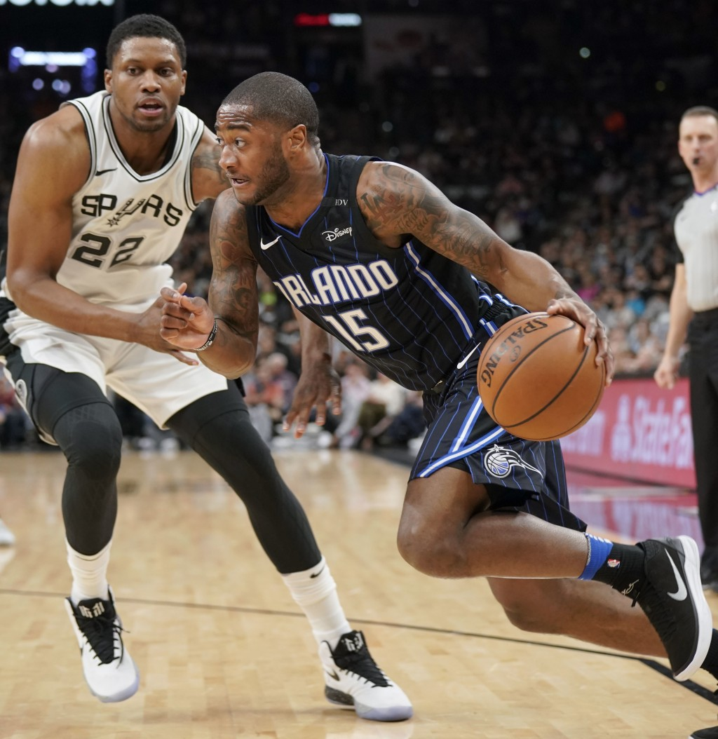 Orlando Magic's Rodney Purvis (15) drives around San Antonio Spurs' Rudy Gay during the first half of an NBA basketball game, Tuesday, March 13, 2018,