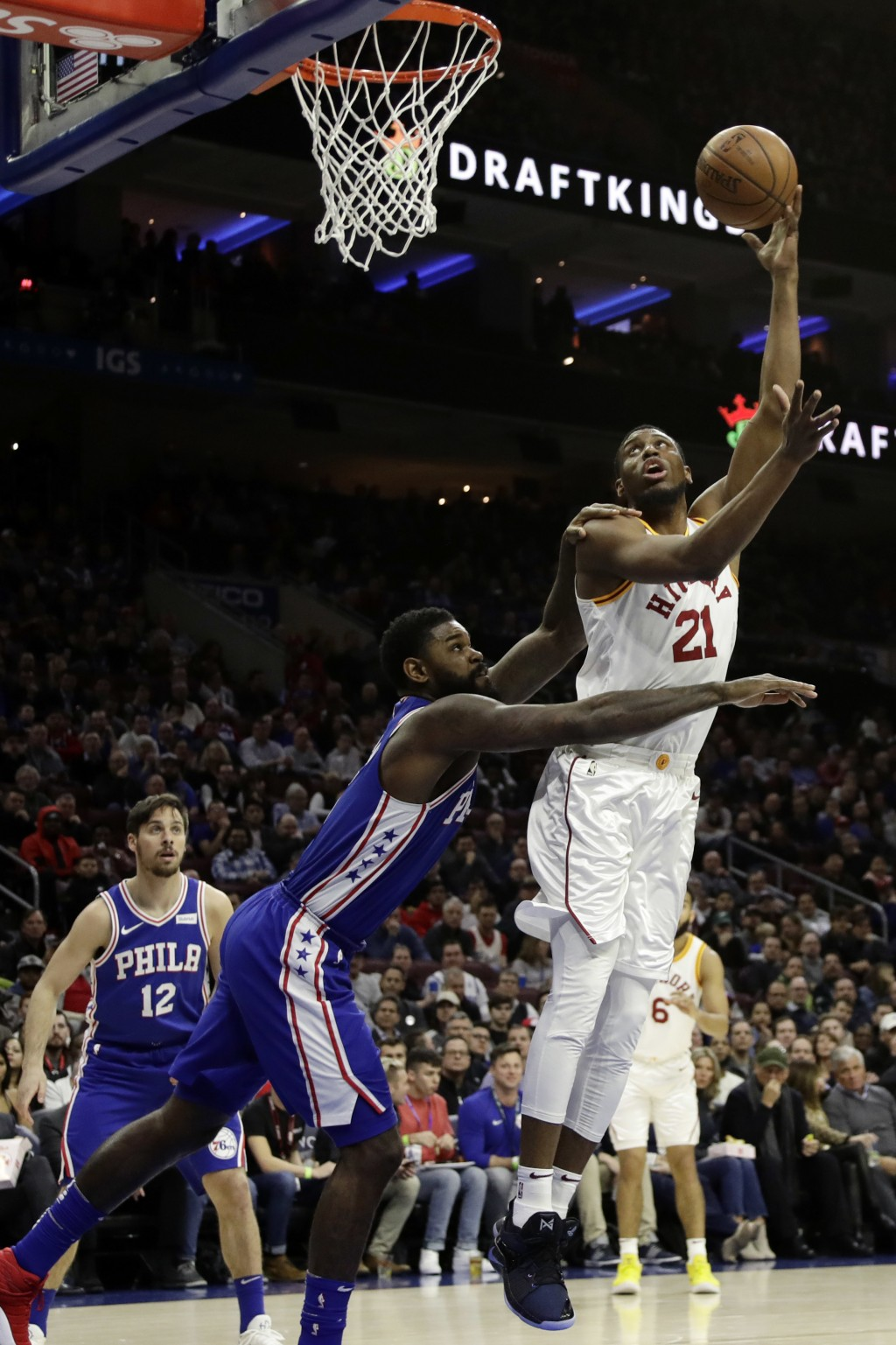 Indiana Pacers' Thaddeus Young, right, goes up for a shot against Philadelphia 76ers' Amir Johnson during the first half of an NBA basketball game, Tu