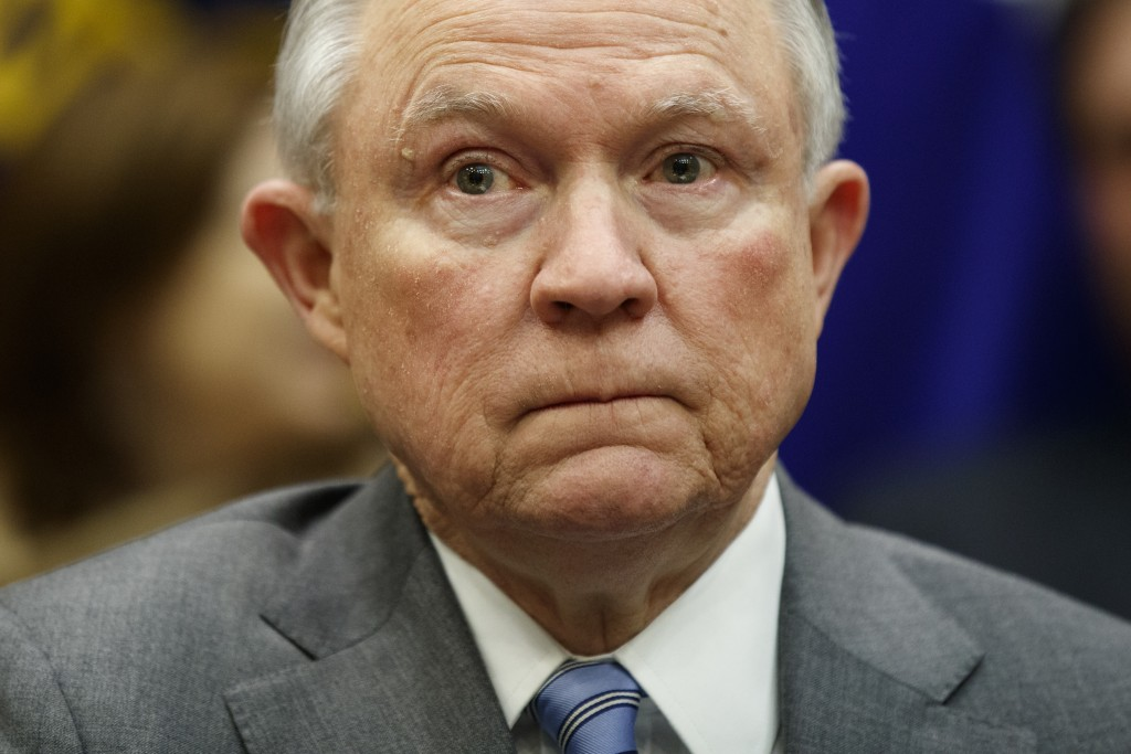 FILE - In this Feb. 22, 2018, file photo, Attorney General Jeff Sessions listens during a meeting between President Donald Trump in the Roosevelt Room...