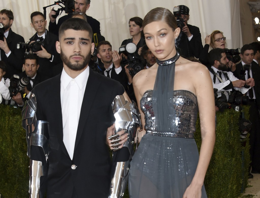 FILE - In this May 2, 2016 file photo, Zayn Malik, left, and Gigi Hadid arrive at The Metropolitan Museum of Art Costume Institute Benefit Gala in New