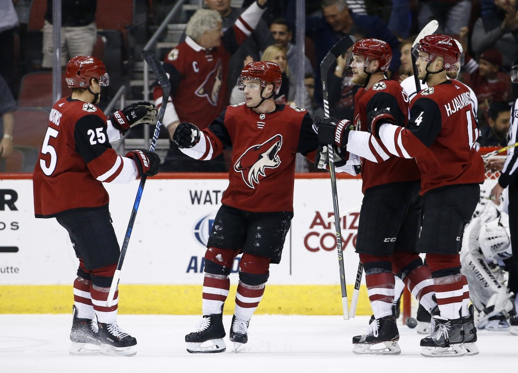 Arizona Coyotes center Nick Cousins (25) celebrates his goal against the Los Angeles Kings with left wing Max Domi, second from left,, defenseman Kevi