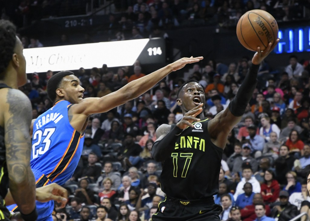 Atlanta Hawks guard Dennis Schroder (17) shoots with Oklahoma City Thunder guard Terrance Ferguson (23) defending during the first half of an NBA bask