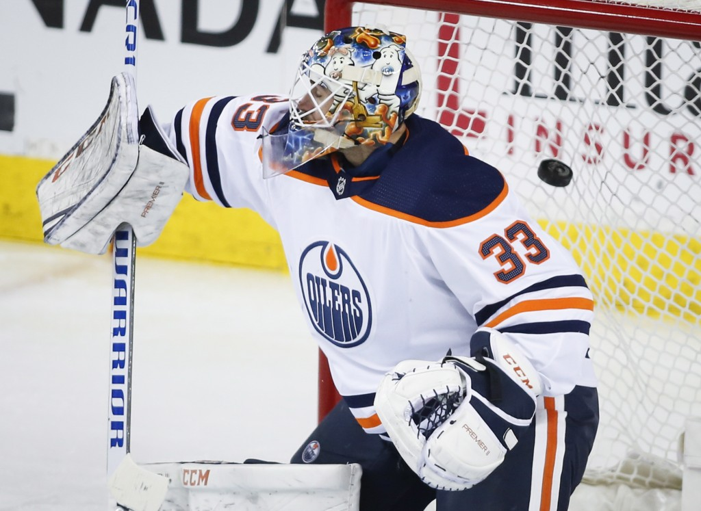 Edmonton Oilers goaltender Cam Talbot (33) lets in a goal against the Calgary Flames in the second period of an NHL hockey game, Tuesday, March 13, 20