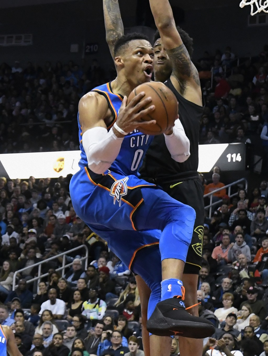 Oklahoma City Thunder guard Russell Westbrook (0) goes to the basket with Atlanta Hawks guard Isaiah Taylor defending during the second half of an NBA