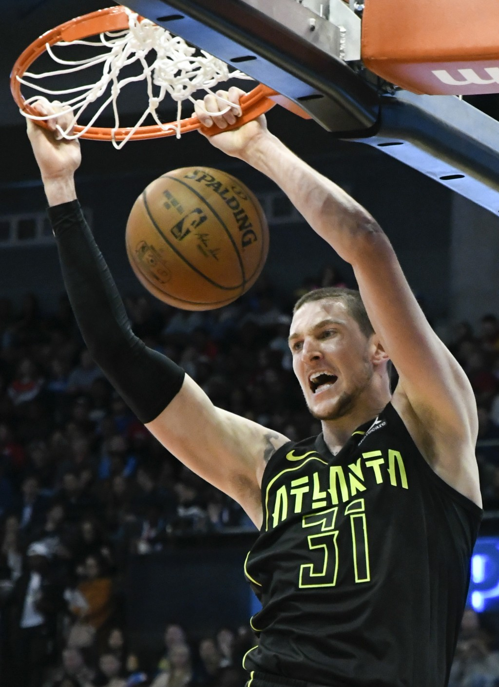 Atlanta Hawks forward Mike Muscala dunks against the Oklahoma City Thunder during the first half of an NBA basketball game, Tuesday, March 13, 2018, i