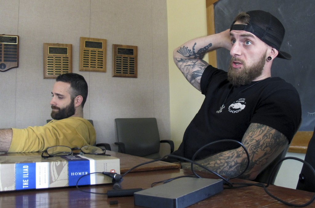 "In this Feb. 12, 2018 photo, University of Vermont student veterans Thomas Moore, left, and Dan Wright, participate in a class studying Homer's ""The I"