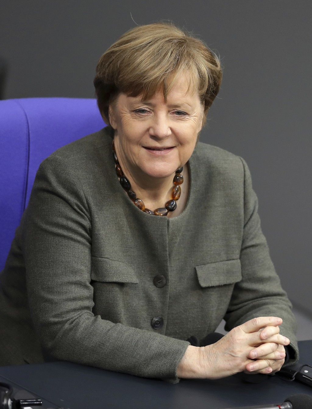 FILE -- In this Monday, Jan. 22, 2018 photo German Chancellor Angela Merkel attends a meeting of the German parliament, Bundestag, at the Reichstag bu