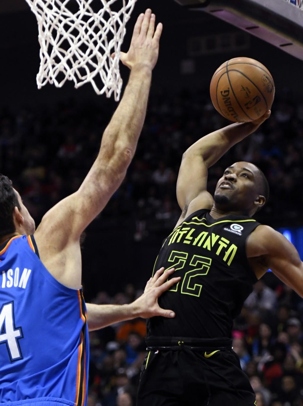 Atlanta Hawks guard Isaiah Taylor (22) shoots as Oklahoma City Thunder center Dakari Johnson defends during the first half of an NBA basketball game,