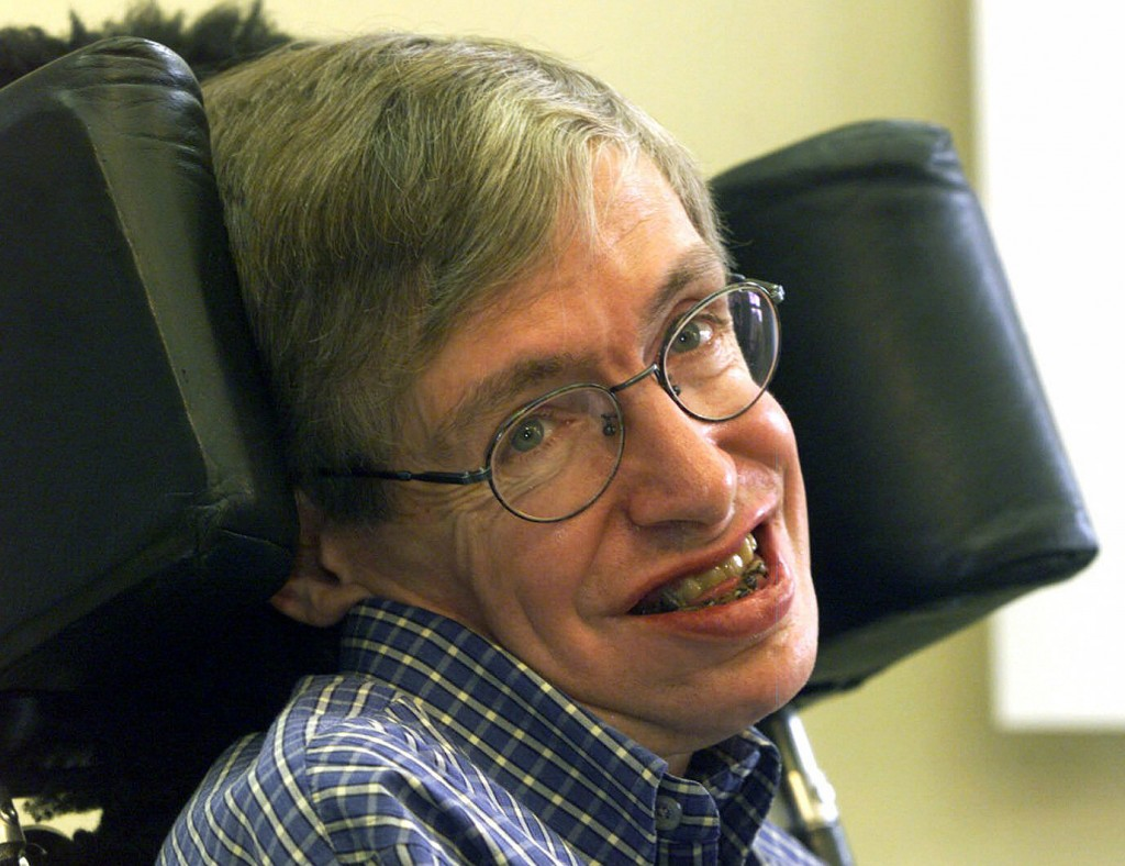 FILE - In this Wednesday, July 21, 1999 file photo Professor Stephen Hawking smiles during a news conference at the University of Potsdam, near Berlin