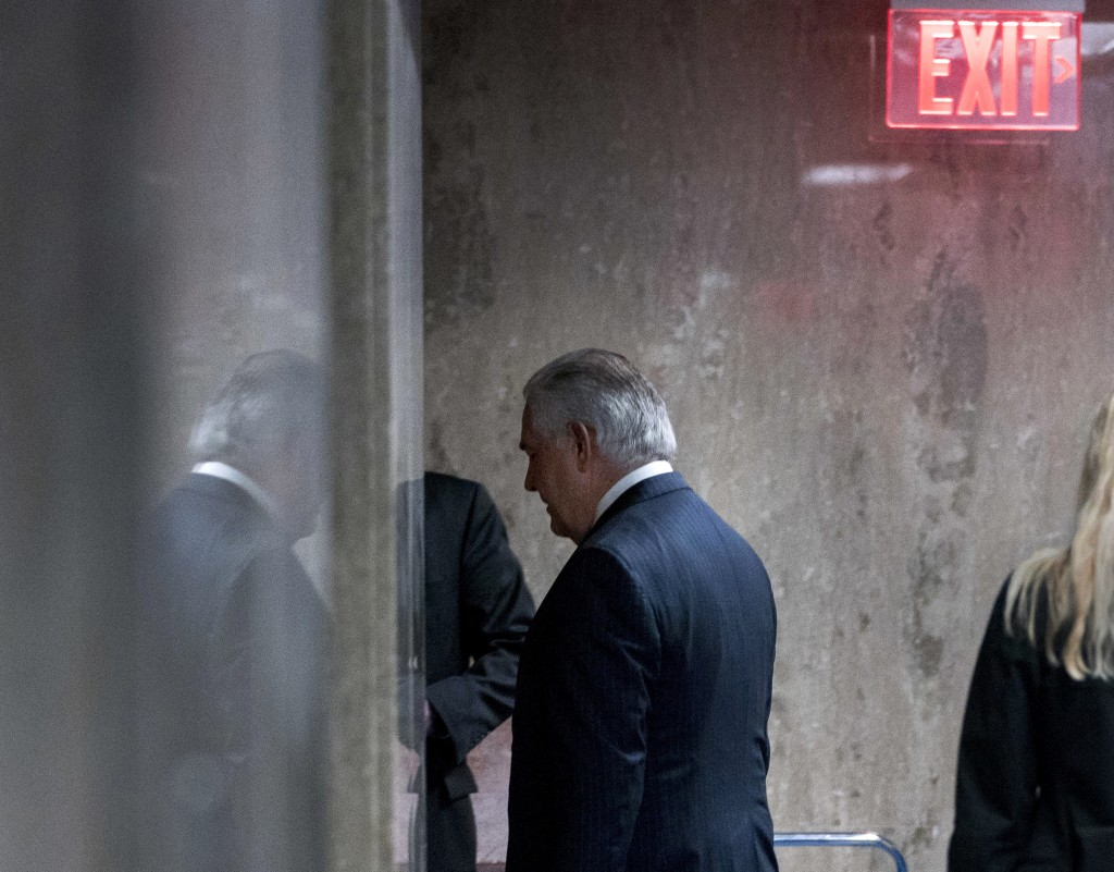Secretary of State Rex Tillerson walks down a hallway after speaking at a news conference at the State Department in Washington, Tuesday, March 13, 20