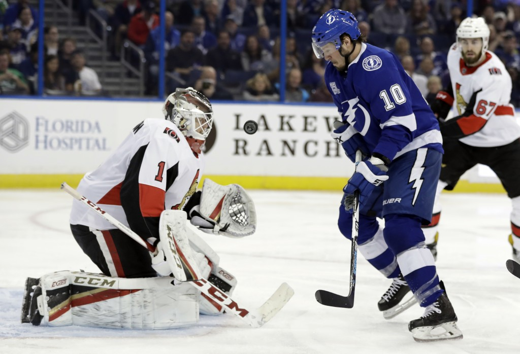 Ottawa Senators goaltender Mike Condon (1) makes a save on a shot by Tampa Bay Lightning center J.T. Miller (10) during the second period of an NHL ho