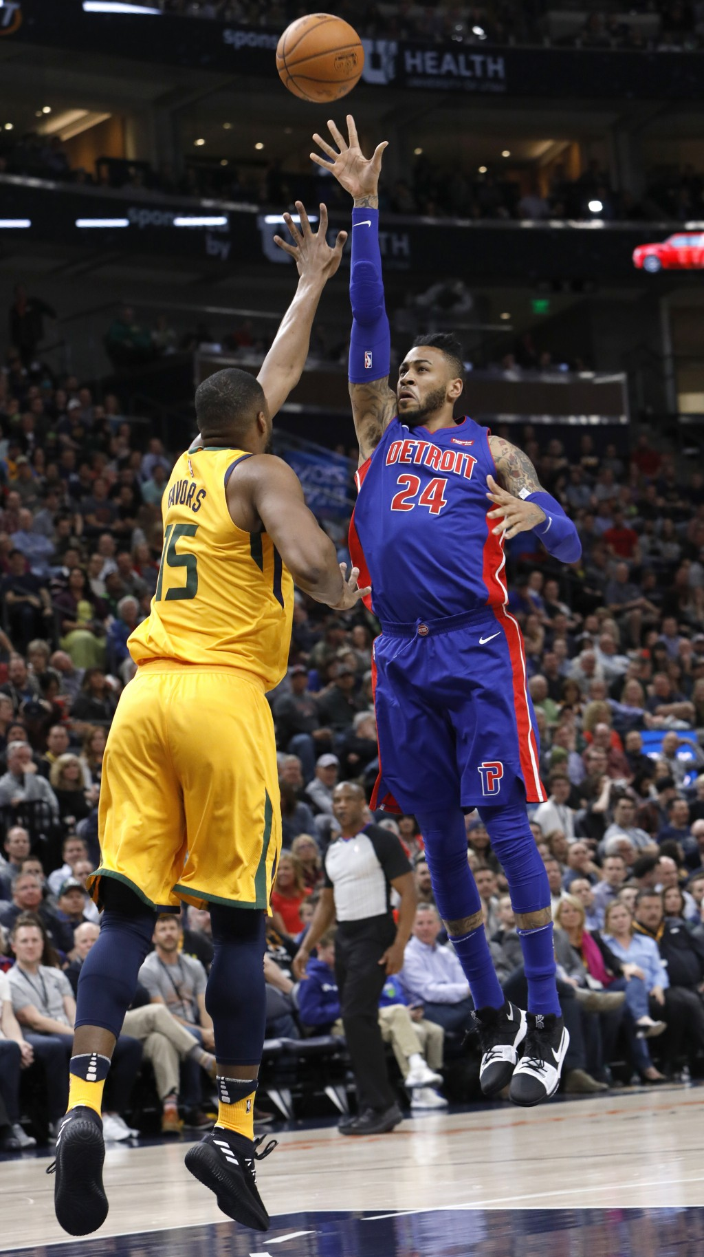 Detroit Pistons' Eric Moreland (24) shoots the ball as Utah Jazz's Derrick Favors (15) defends in the first half of an NBA basketball game on Tuesday,