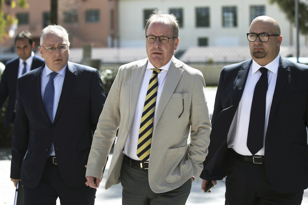 Austrian Herbert Huebel, center, chairman of the FIFA monitoring committee for the Hellenic Football Federation arrives for a press conference in Athe