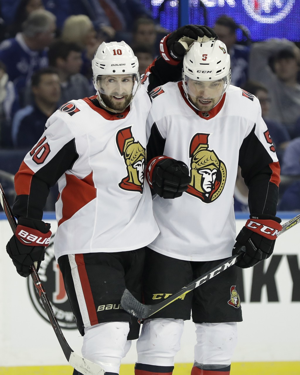 Ottawa Senators left wing Tom Pyatt (10) celebrates his goal against the Tampa Bay Lightning with defenseman Cody Ceci (5) during the first period of
