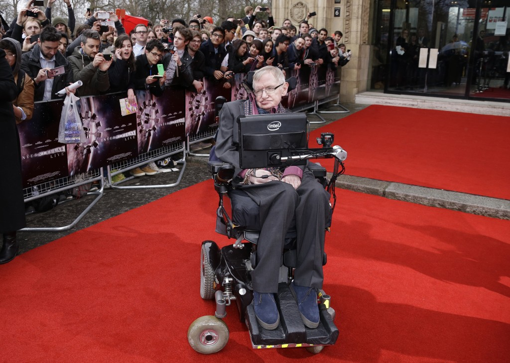 FILE - In this March 30, 2015 file photo, Professor Stephen Hawking poses for photographers upon arrival for the Interstellar Live show at the Royal A