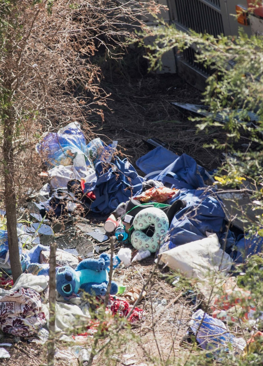 Personal items are scattered near the site where a tour bus crashed into a ravine in Loxley, Ala., Tuesday, March 13, 2018. The bus carrying dozens of