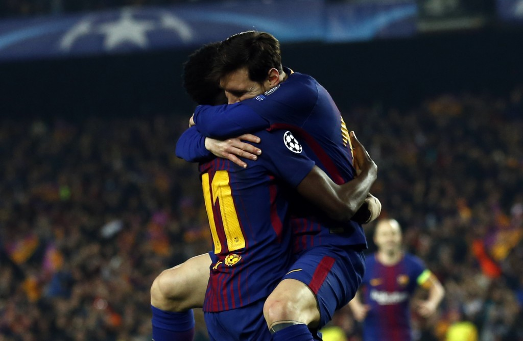 Barcelona's Ousmane Dembele, left, celebrates with Lionel Messi after scoring his side's second goal during the Champions League round of sixteen seco