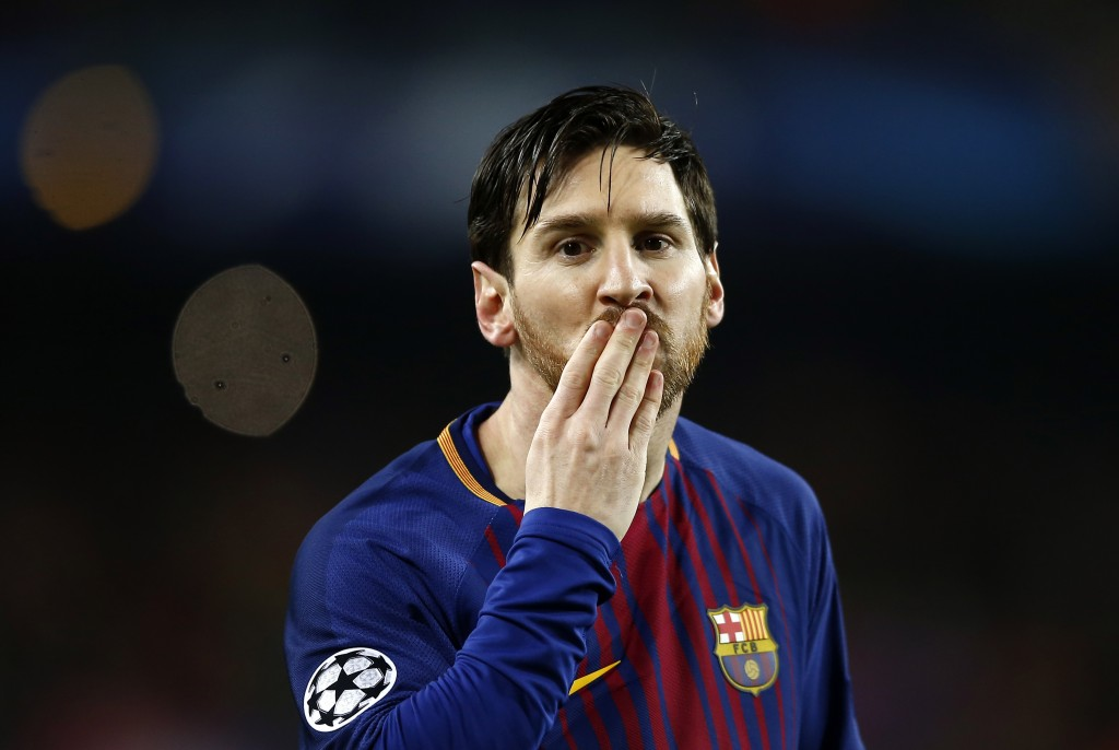 Barcelona's Lionel Messi blows a kiss after scoring the opening goal during the Champions League round of sixteen second leg soccer match between FC B