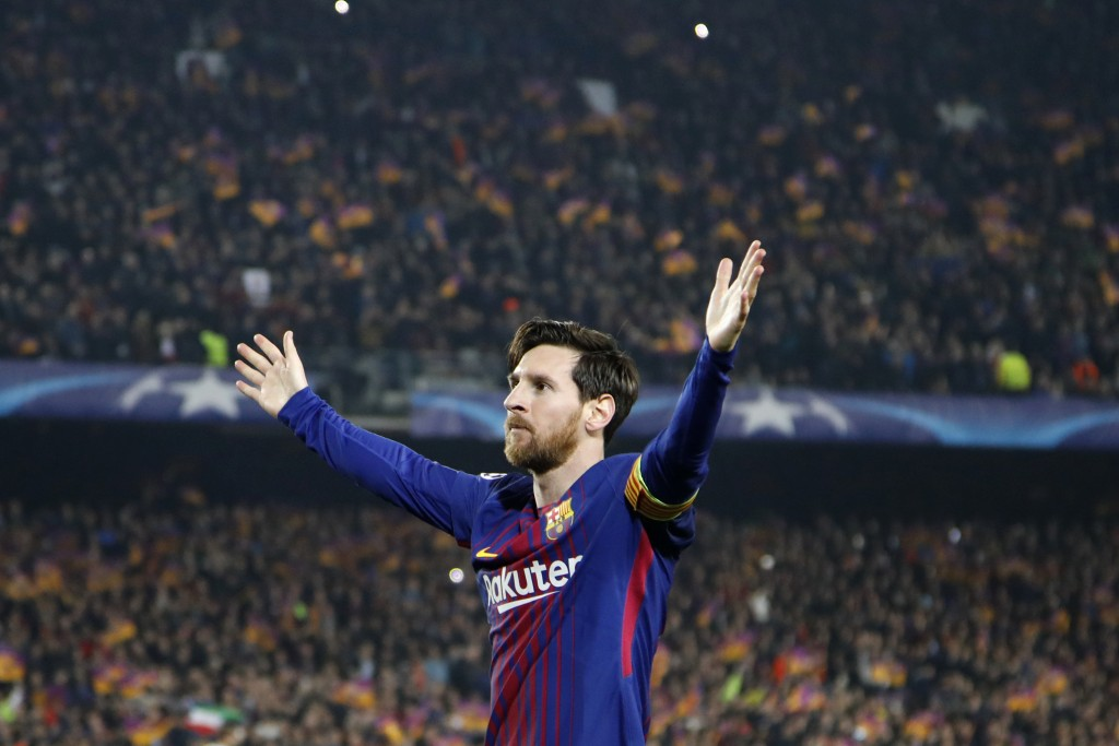 Barcelona's Lionel Messi celebrates after scoring his side's third goal during the Champions League round of sixteen second leg soccer match between F