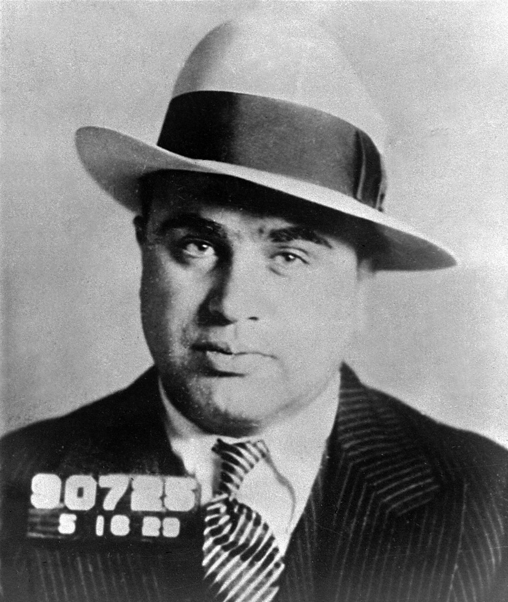 FILE - Chicago gangster Al Capone has his photo taken while in custody in Philadelphia, May 18, 1929, on charges of carrying concealed weapons. It was...