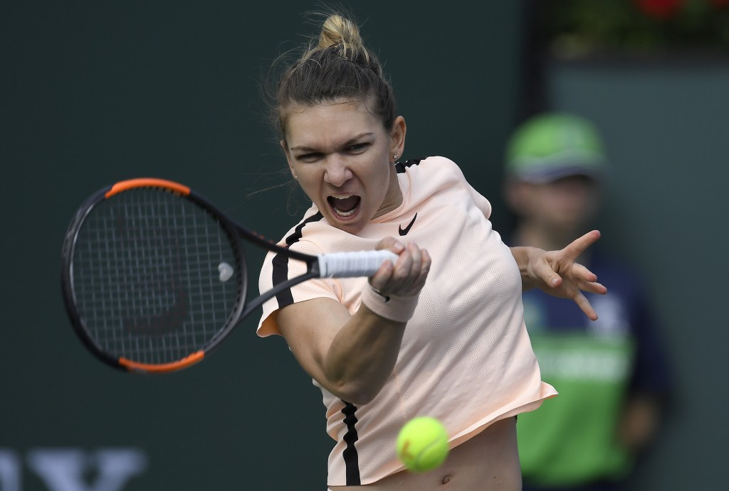 Simona Halep, of Romania, hits a forehand to Petra Martic, of Croatia, during the quarterfinals at the BNP Paribas Open tennis tournament Wednesday, M