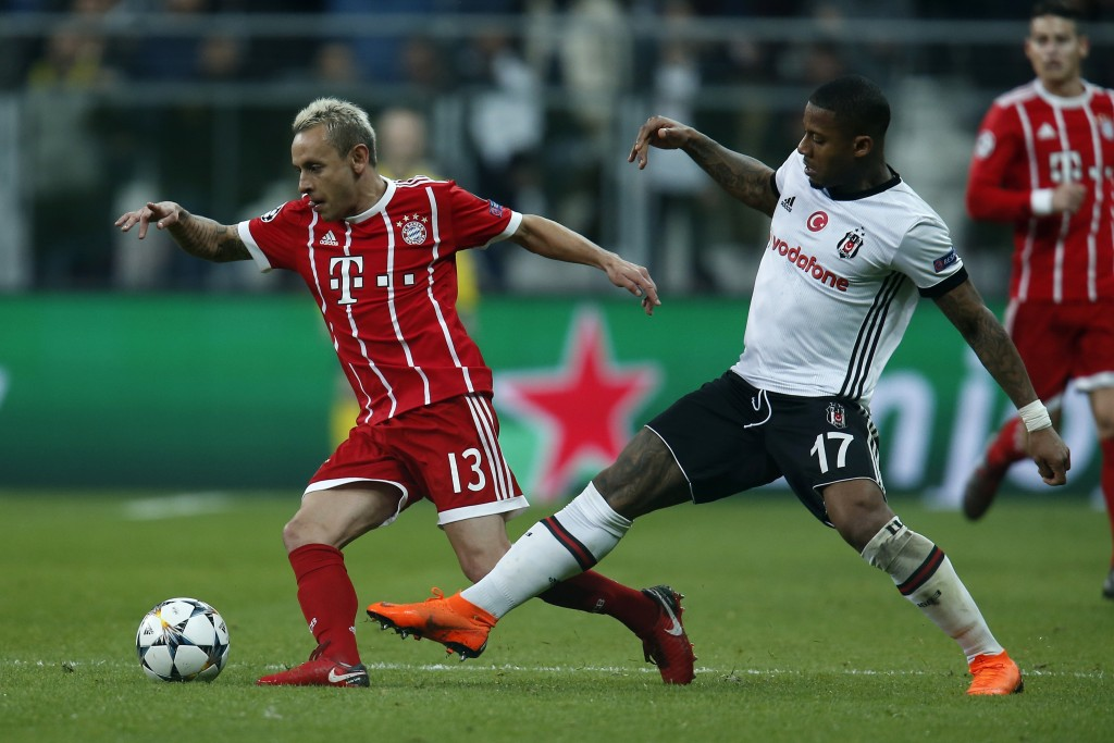 Bayern's Rafinha, left, and Besiktas' Jeremain Lens challenge for the ball during the Champions League, round of 16, second leg, soccer match between