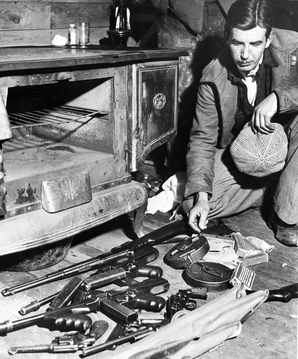 FILE -  John Dillinger's arsenal is seen, April 24, 1934, after federal agents tried to capture him and his gang in their hideout in the Little Bohemi...