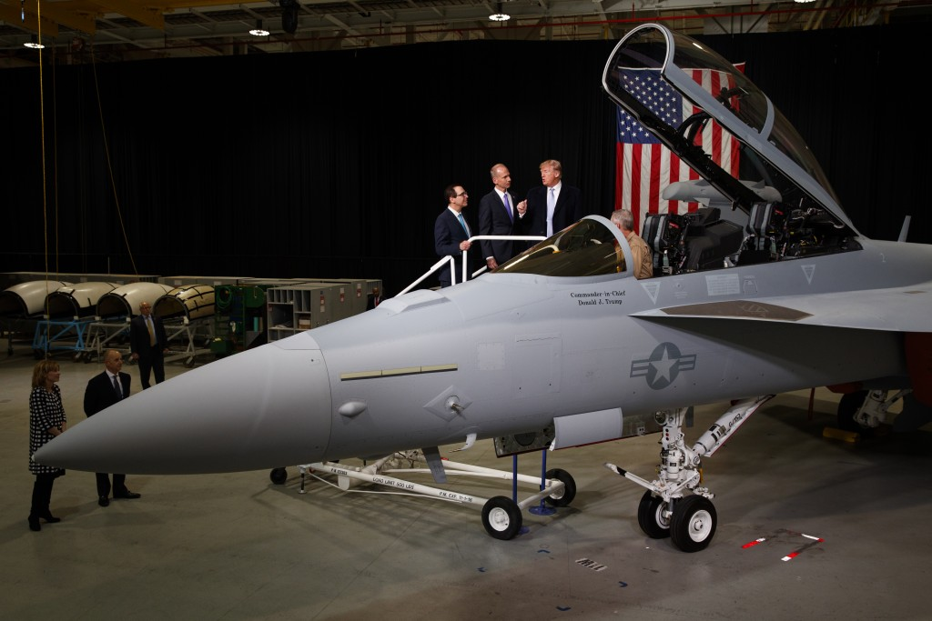 Treasury Secretary Steve Mnuchin and Boeing CEO Dennis Muilenburg listen to President Donald Trump talk with Boeing test pilot Steve Schmidt during a