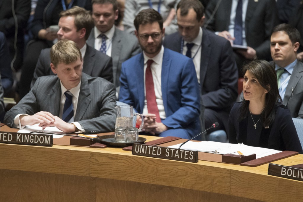 British Deputy Ambassador to the United Nations Jonathan Allen, right, listens as American Ambassador to the United Nations Nikki Haley speaks during