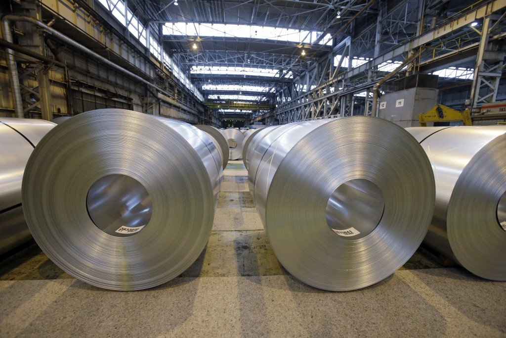 FILE- In this Feb. 15, 2013, file photo, finished galvanized steel coils await shipment at ArcelorMittal Steel's hot dip galvanizing line in Cuyahoga