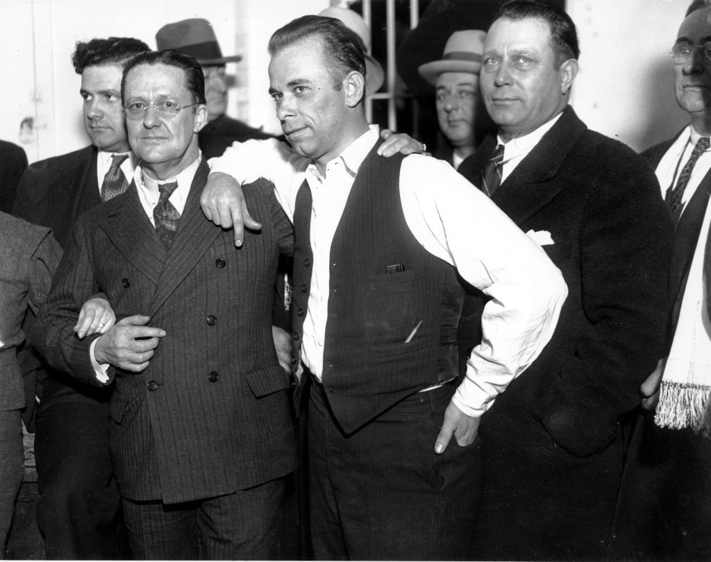 FILE -  John Dillinger, center, strikes a pose with Lake County prosecutor Robert Estill, left, in the jail at Crown Point, Ind., in 1934. Dillinger w...
