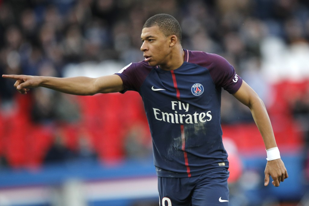 PSG's Kylian Mbappe celebrates his side's second goal during the French League One soccer match between Paris Saint-Germain and Angers at the Parc des