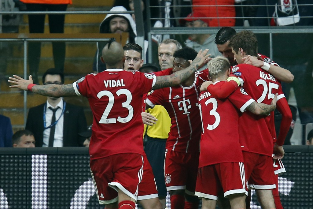 Bayern's players celebrate the third goal of their team during the Champions League, round of 16, second leg, soccer match between Besiktas and Bayern