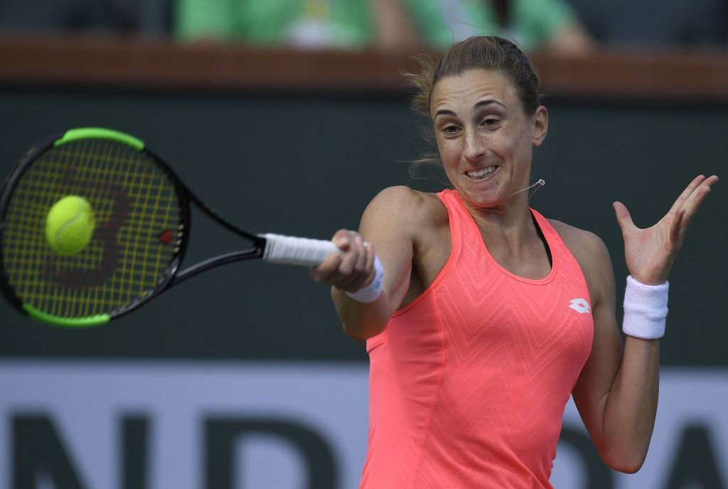 Petra Martic, of Croatia, returns a shot to Simona Halep, of Romania, during the quarterfinals at the BNP Paribas Open tennis tournament, Wednesday, M
