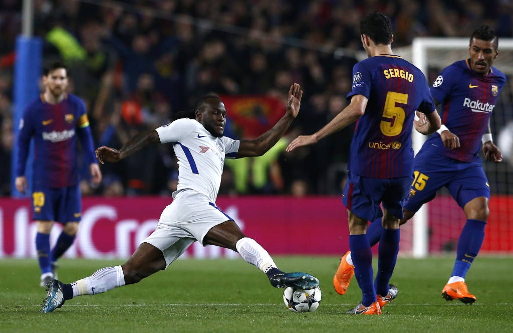 Chelsea's Victor Moses, center left, vies for the ball with Barcelona's Sergio Busquets during the Champions League round of sixteen second leg soccer