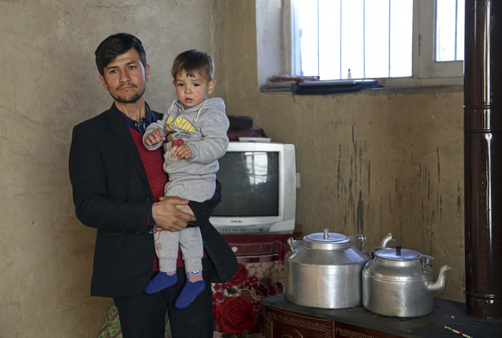 Asadullah Poya with his 18-month-old son Donald Trump, poses for a photograph at their rented house in Kabul, Afghanistan, Thursday, March 15, 2018. P...
