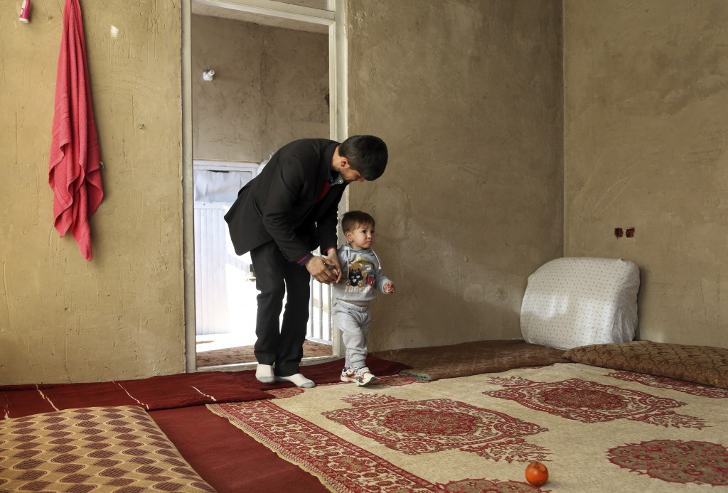 Asadullah Poya with his 18-month-old son Donald Trump, arrive for interview with The Associated Press at their rented house in Kabul, Afghanistan, Thu...