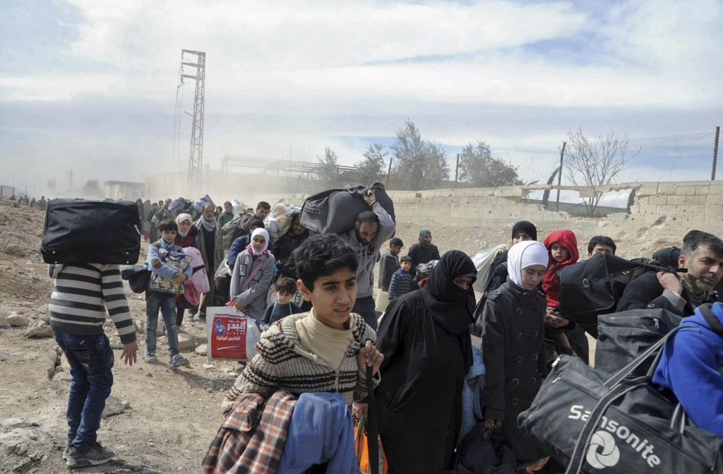More than 50000 flee twin offensives in Syria as crisis deepens